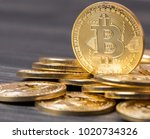 bitcoin on wooden table top | Shutterstock . vector #1020734326