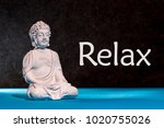 relaxed buddha figurine sitting ...   Shutterstock . vector #1020755026