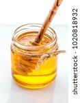 jar of honey with honey dipper  ... | Shutterstock . vector #1020818932