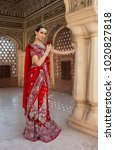 indian woman in red bridal sari ...   Shutterstock . vector #1020827818