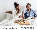 a couple having breakfast in bed | Shutterstock . vector #1020833788
