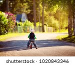 Child Riding On A Bicycles At...