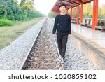 a thai boy is walking on the... | Shutterstock . vector #1020859102