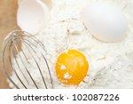 egg into the flour - stock photo