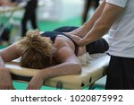 athlete's back massage after... | Shutterstock . vector #1020875992