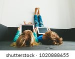 little boy and girl looking at... | Shutterstock . vector #1020888655