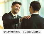 the happy businessmen pat on... | Shutterstock . vector #1020928852