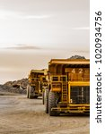 Small photo of Rustenburg, South Africa, 10/15/2012, Dump Trucks transporting Platinum ore for processing