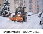 excavator cleans the streets of ... | Shutterstock . vector #1020942268