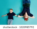 mom and sons  portrait on blue... | Shutterstock . vector #1020985792