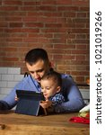 dad and child boy together with ... | Shutterstock . vector #1021019266