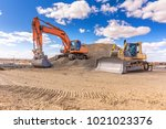 group of excavator working on a ... | Shutterstock . vector #1021023376