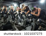 group of sporty women using... | Shutterstock . vector #1021037275