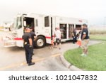 blurred fire truck visits to... | Shutterstock . vector #1021047832