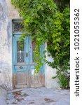 abandoned forgotten doorway... | Shutterstock . vector #1021055362