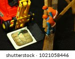 damaged sim card and miniature...   Shutterstock . vector #1021058446