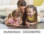 happy mom and her children... | Shutterstock . vector #1021060552