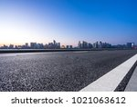 empty road with panoramic... | Shutterstock . vector #1021063612