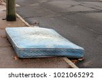 old mattress sitting outside on ... | Shutterstock . vector #1021065292
