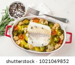 fish cod baked in the oven with ... | Shutterstock . vector #1021069852