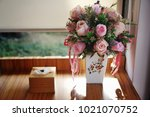 flower vase on wooden table and ... | Shutterstock . vector #1021070752