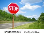 stop sign by the empty road | Shutterstock . vector #102108562