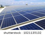 solar pv rooftop with workers... | Shutterstock . vector #1021135132