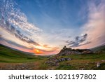 Small photo of Beautiful landscape and a sunset sky over Enisala old stronghold citadel,Dobrogea,Romania