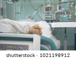 Small photo of Patient in serious condition connected to the life support devices.