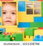 kid looking through door of toy ...   Shutterstock . vector #1021208788