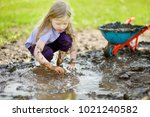 funny little girl playing in a... | Shutterstock . vector #1021240582