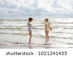 two little sisters having fun... | Shutterstock . vector #1021241455