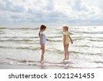 two little sisters having fun... | Shutterstock . vector #1021241455