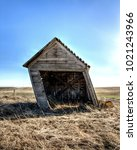 Small photo of An old shed in eastern Washington is leaning a great deal.