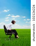 bright picture of serious businesswoman looking forward on the meadow - stock photo