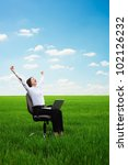 bright picture of happy young woman with laptop on the meadow - stock photo