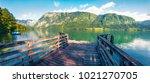 old wooden pier on bohinj lake. ... | Shutterstock . vector #1021270705