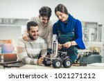 young students of robotics... | Shutterstock . vector #1021271212