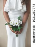 the bride is holding a bouquet... | Shutterstock . vector #1021287775