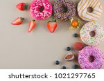 frame of colorful doughnuts... | Shutterstock . vector #1021297765