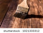 male hand paint wooden surface... | Shutterstock . vector #1021333312