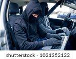 car thief  car theft | Shutterstock . vector #1021352122