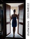 girl in the blue dress stands... | Shutterstock . vector #1021368112