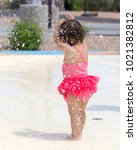 baby girl playing on a splash... | Shutterstock . vector #1021382812
