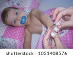 baby boy shows his bandaged... | Shutterstock . vector #1021408576
