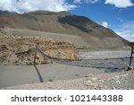 pedestrian suspension bridge... | Shutterstock . vector #1021443388