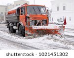 city after blizzard. large plow ... | Shutterstock . vector #1021451302