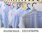 white school uniforms hung for... | Shutterstock . vector #1021456096