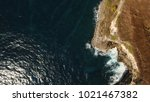 cliff with waves crashing...   Shutterstock . vector #1021467382