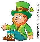 sitting leprechaun theme image... | Shutterstock .eps vector #1021552642